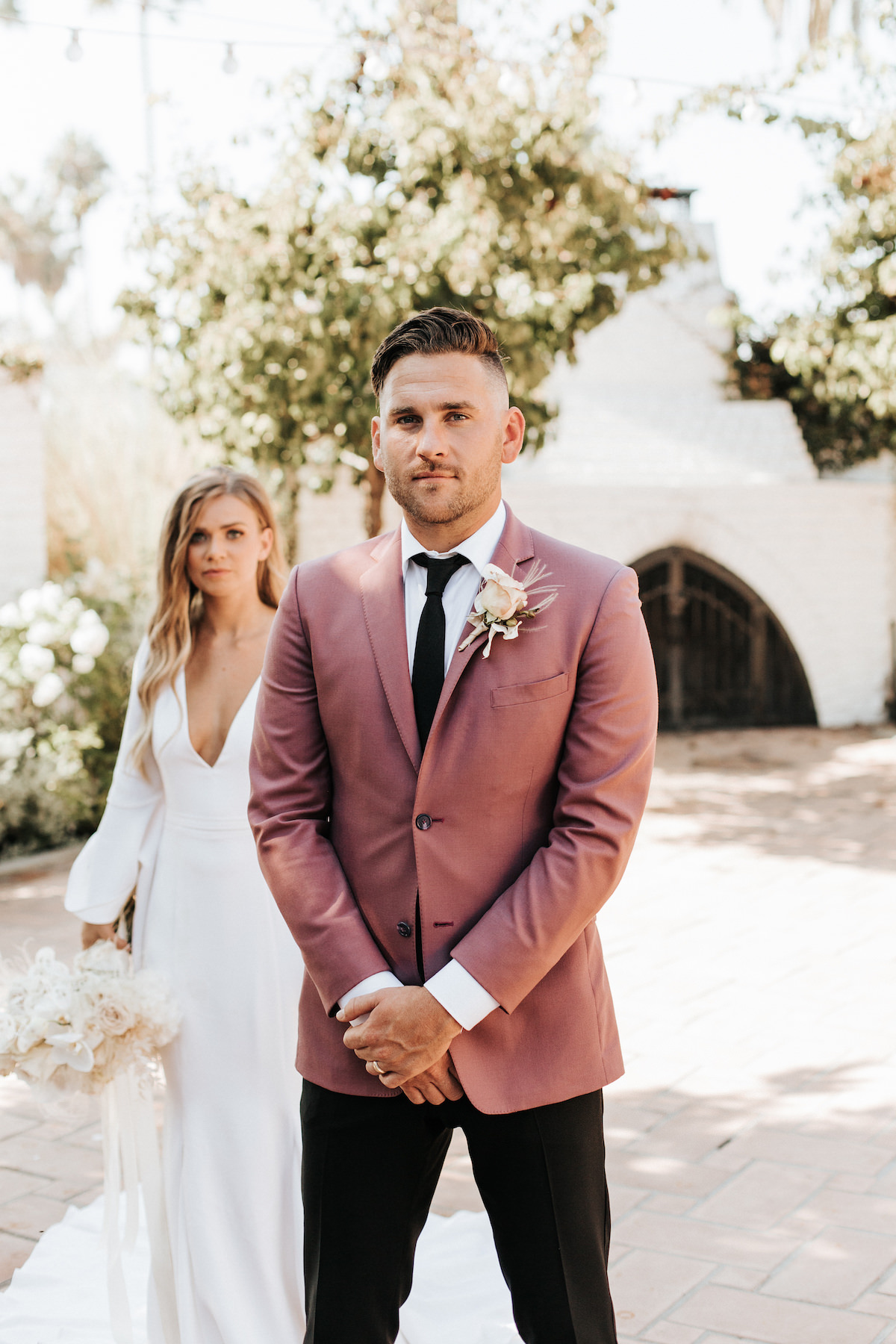 Groom with pink suit jacket - Sydney Bliss Photography