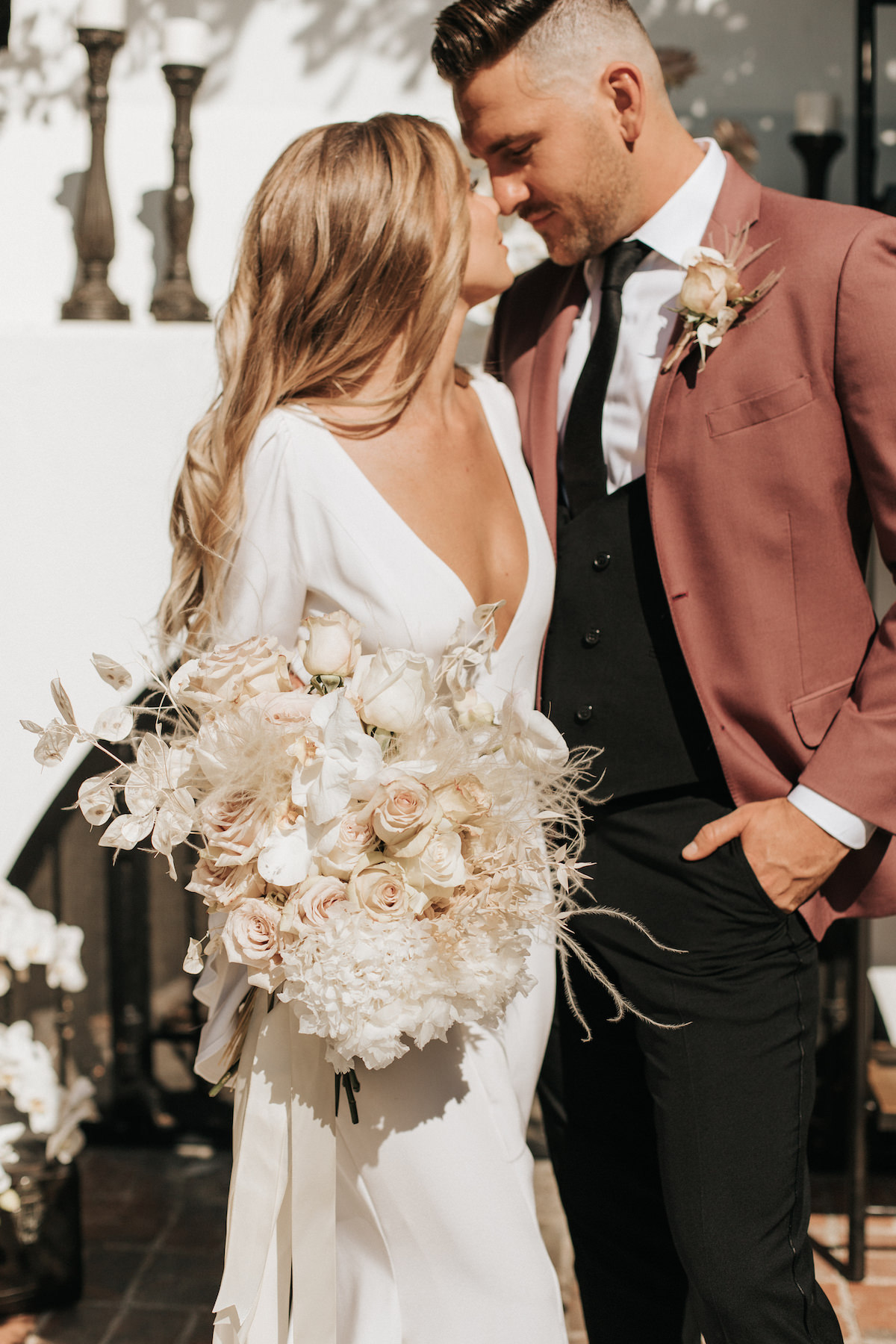 Modern bride and groom photo with blush wedding bouquet - Sydney Bliss Photography