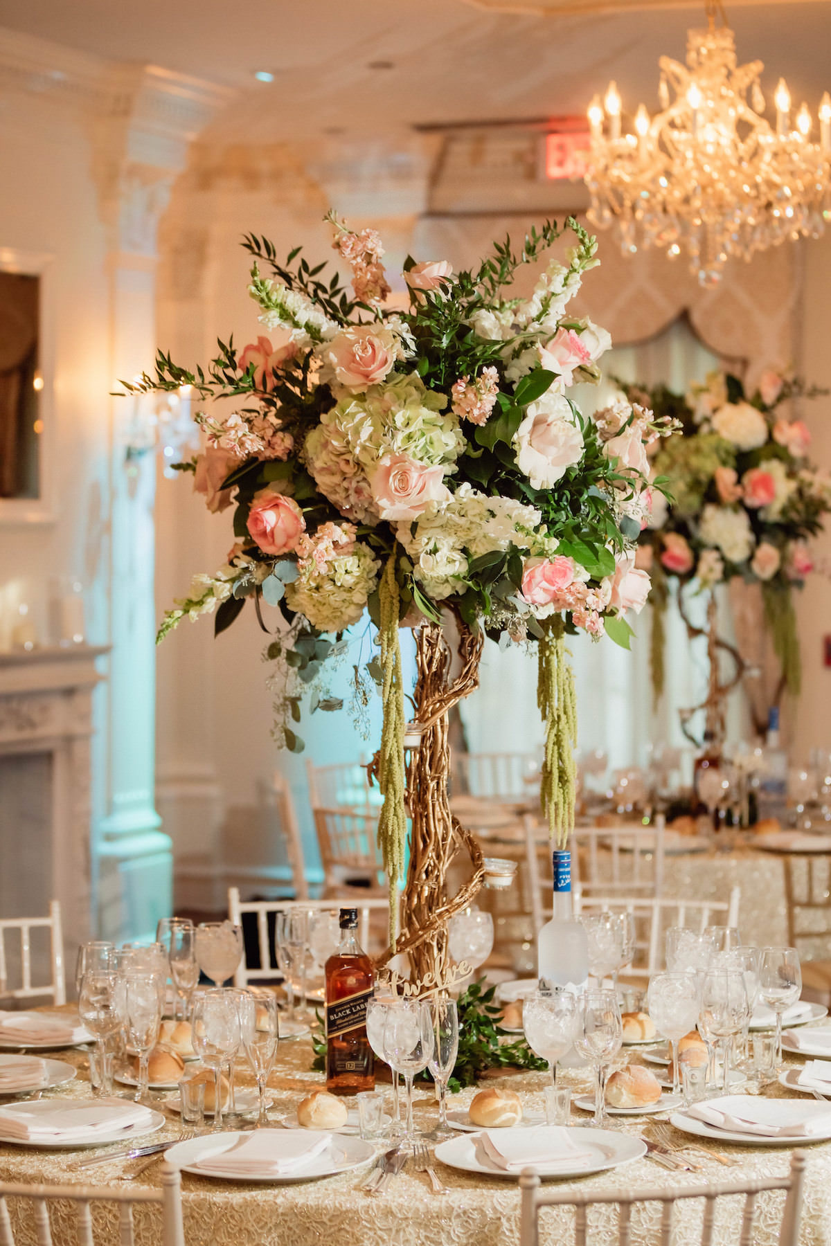 topiary tall wedding centerpiece with pink flowers - Photography: Charming Images