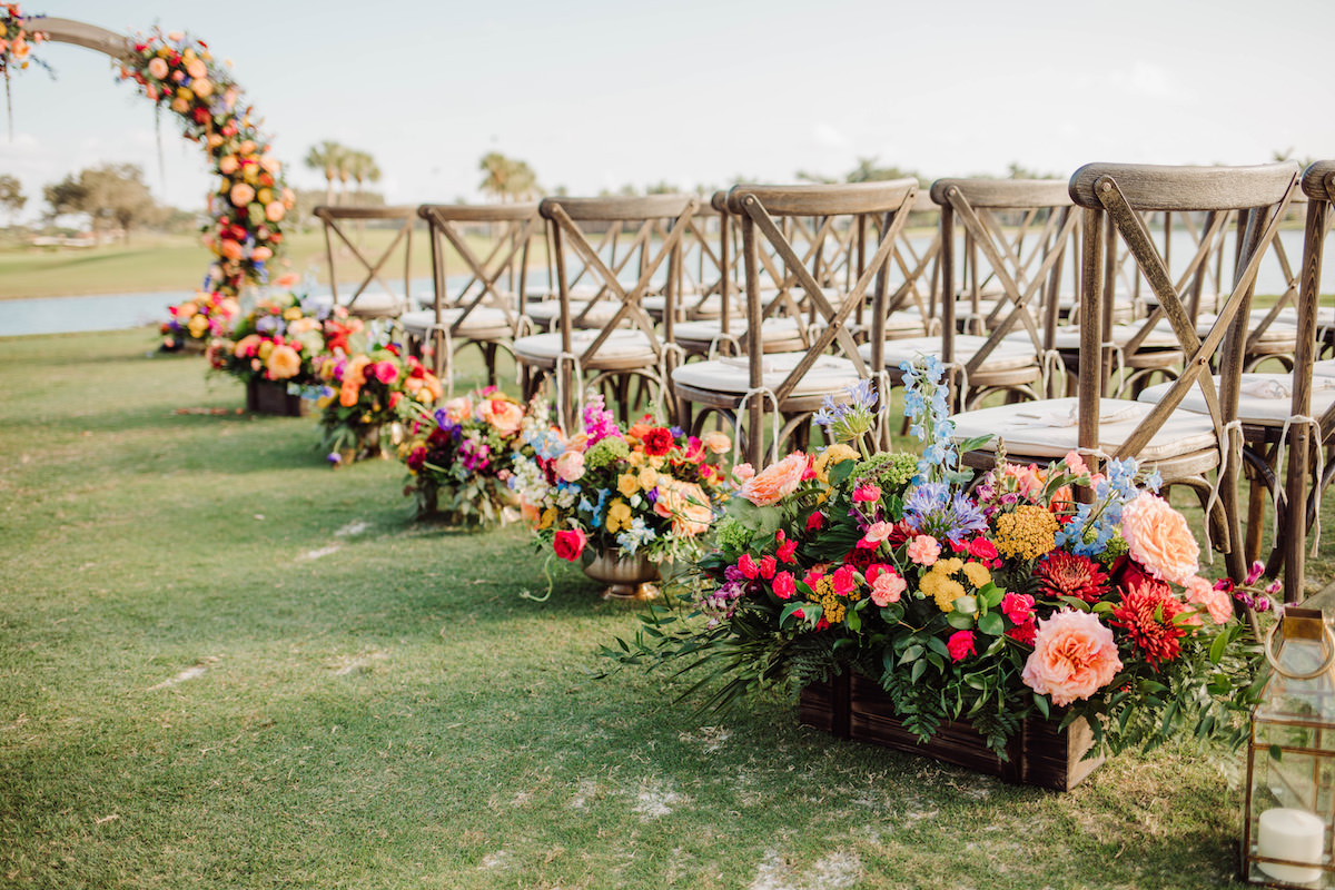 Colorful wedding ceremony aisle flowers - Bohemian Road Photography