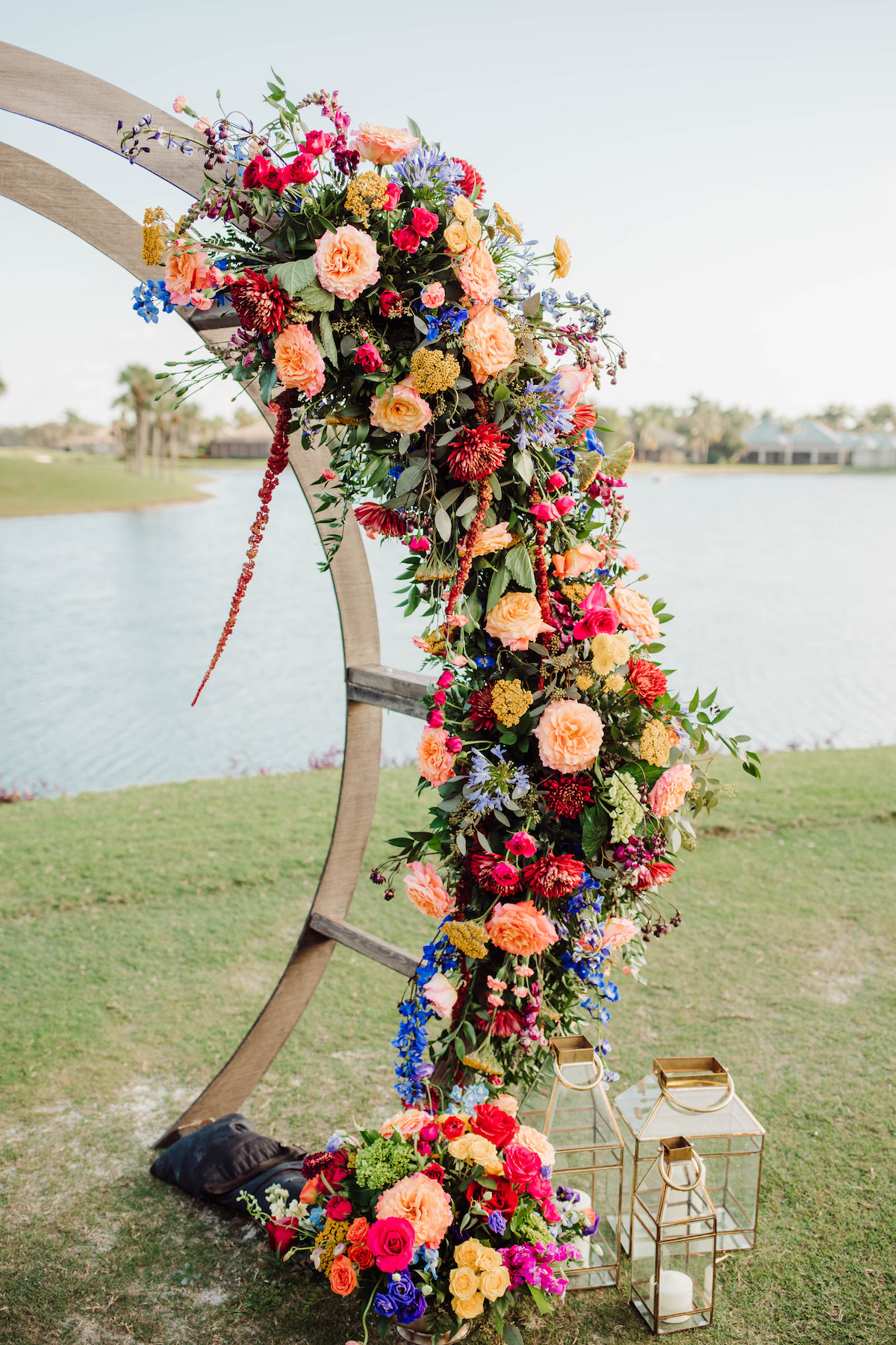 Floral Wedding Ceremony Arch with colorful flowers - Bohemian Road Photography