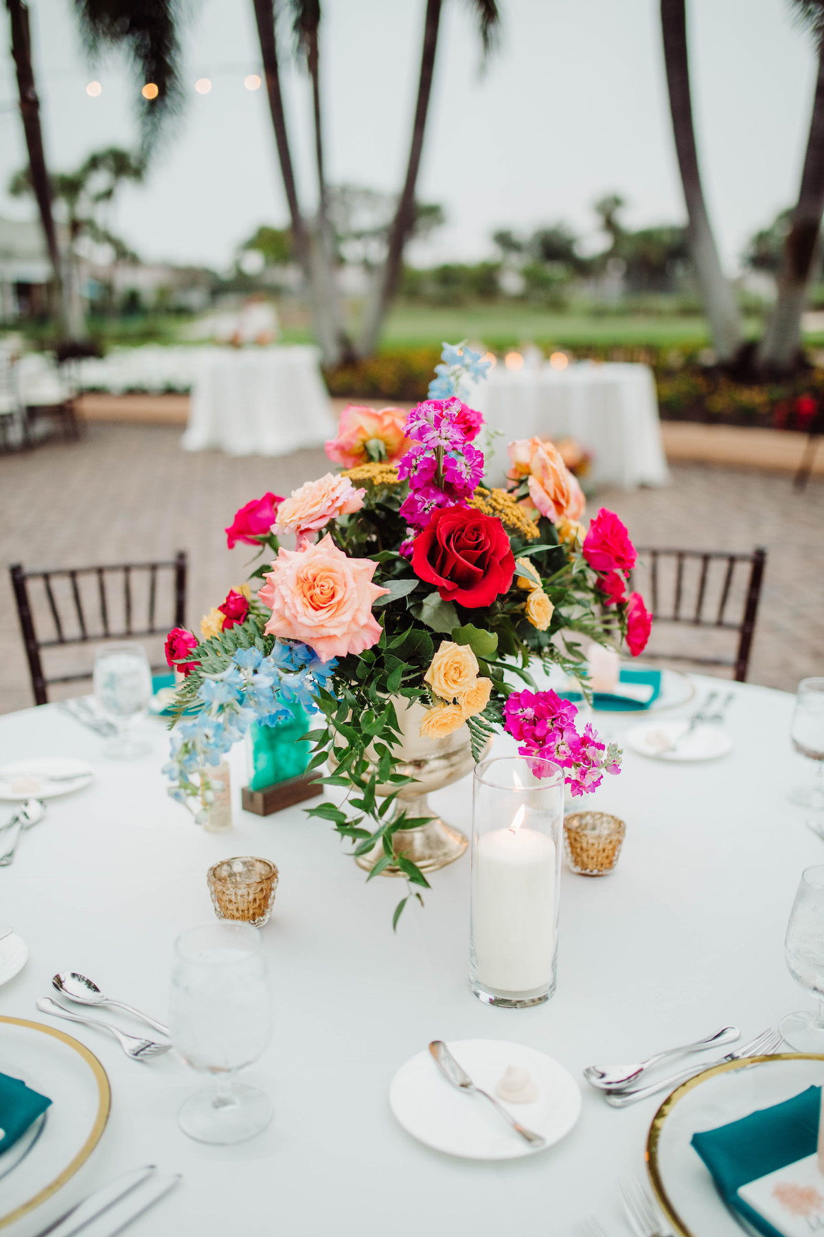 Low colorful wedding centerpiece - Bohemian Road Photography
