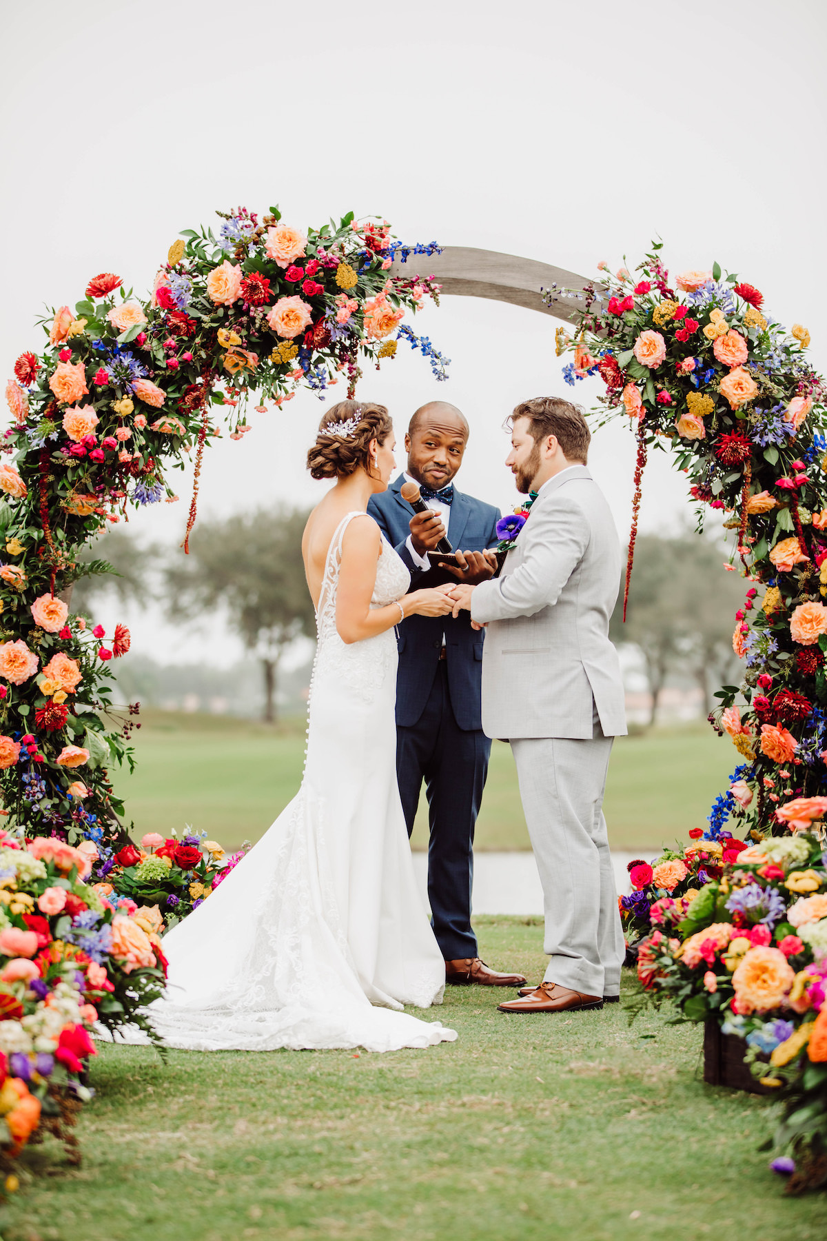 Outdoor wedding ceremony decor with colorful flowers - Bohemian Road Photography