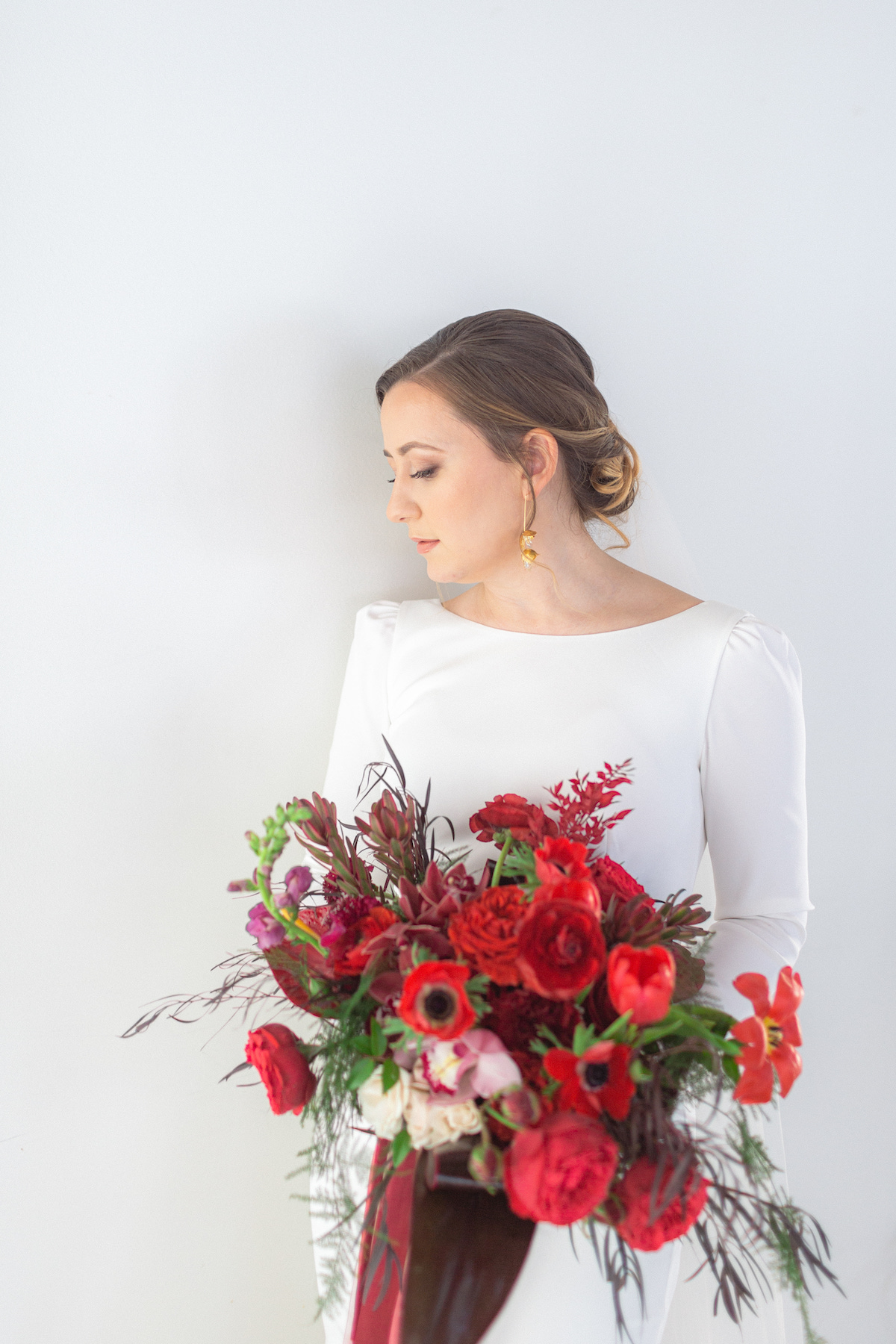Winter bride with red bouquet - 5th Fine Art Photography
