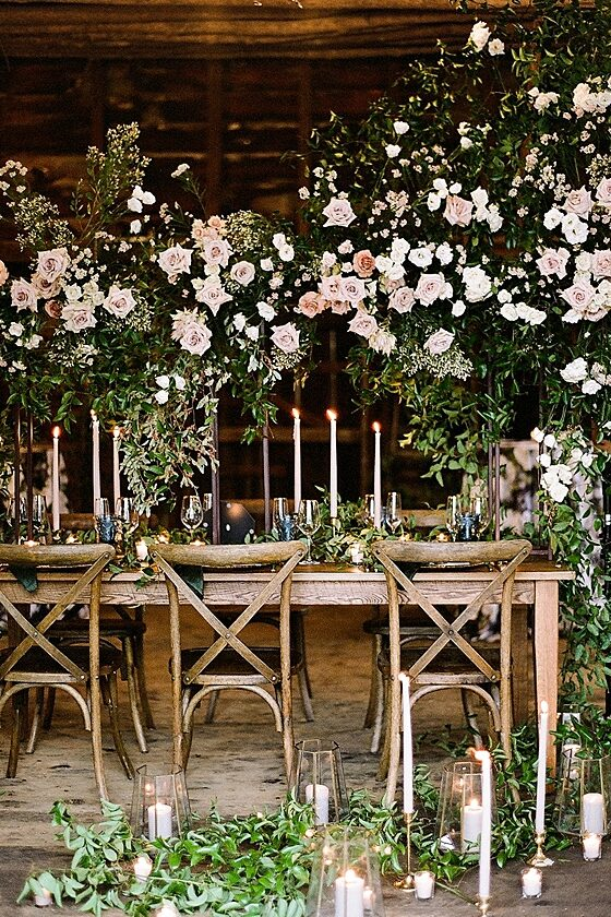 Stunning flower arch reception table decor with candles Barn Wedding -Twah Photography