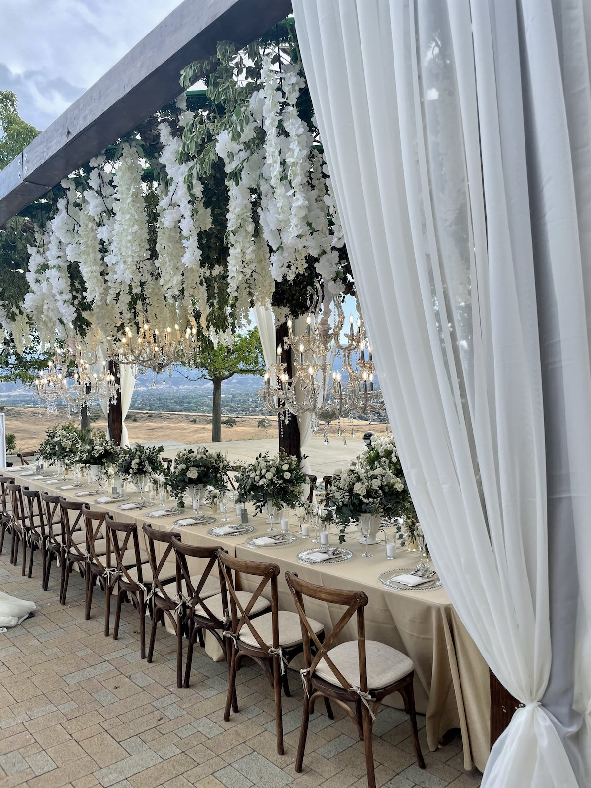 Outdoor wedding reception decor with hanging flowers - Flowers by Edgar